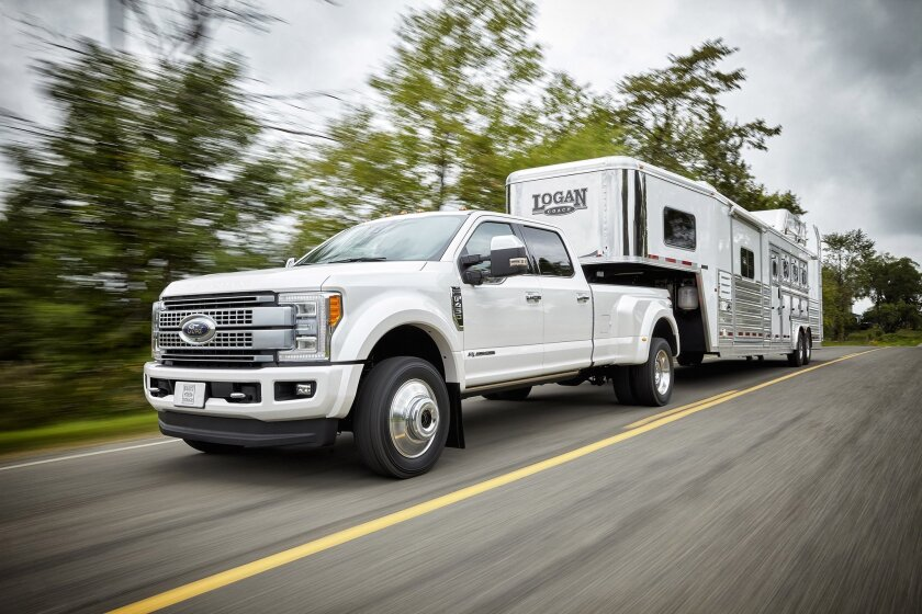 This product image provided by Ford Motor Co. shows the 2016 Super Duty truck. Like their smaller sibling, the Ford F-150 pickup, Ford's Super Duty trucks are getting a new aluminum body. (Ford Motor Co. via AP)