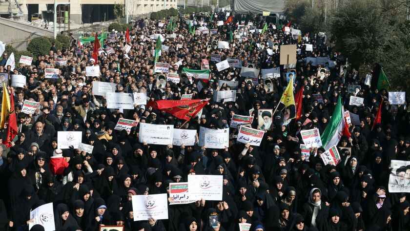 Iranian protesters chant slogans at a rally in Tehran, Iran on Dec. 30.