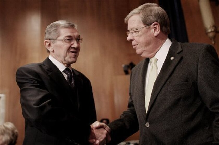 Senate Environment and Public Works Committee member, Sen. Johnny Isakson, R-Ga., right, shakes hands with Tennessee Valley Authority President and Chief Executive Officer Tom Kilgore on Capitol Hill in Washington, Thursday, Jan. 8, 2009, prior to the committee's hearing on the TVA's Kingston Fossi