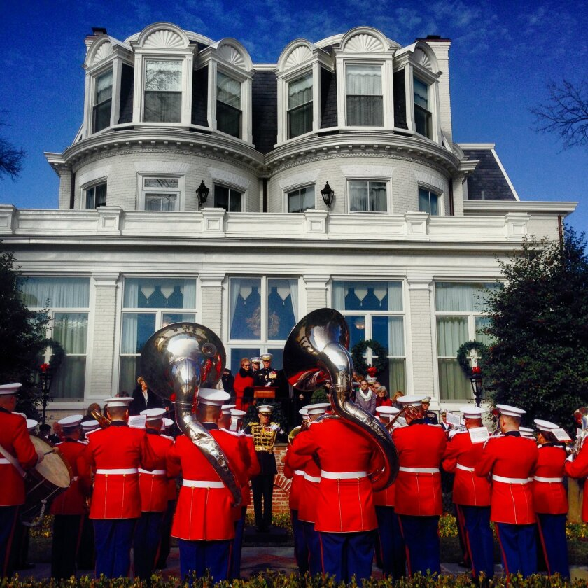 """The Marine Band serenaded Gen. James Amos, his wife, Bonnie, and guests on New Year's Day in a """"surprise"""" tradition dating to 1865."""