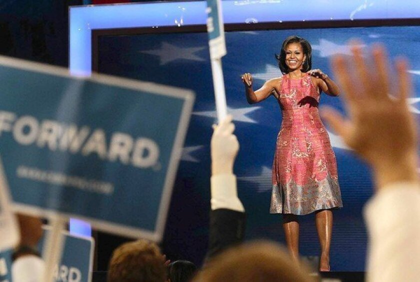 Michelle Obama opens convention with personal pitch
