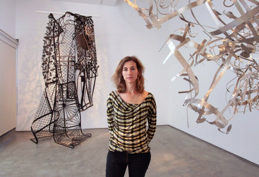 """Of her fascination with gates, artist Margaret Griffith says: """"It was like this infinite source of material, and it continues to be."""""""