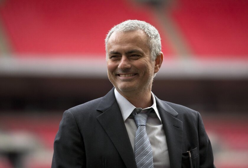 FILE- In this Monday, Feb. 1, 2016 file photo, former Chelsea manager Jose Mourinho smiles as he attends a group photo session pitchside as a guest of FIFA Presidential Candidate Gianni Infantino at Wembley Stadium in London. Manchester United has announced Friday, May 27, 2016, they have hired Jos