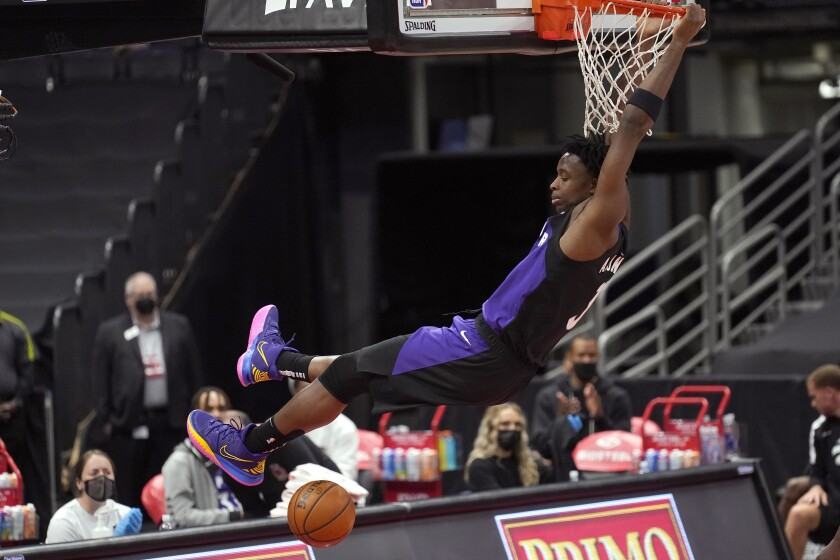 Toronto Raptors forward OG Anunoby (3) follows through on a slam dunk against the Golden State Warriors during the first half of an NBA basketball game Friday, April 2, 2021, in Tampa, Fla. (AP Photo/Chris O'Meara)