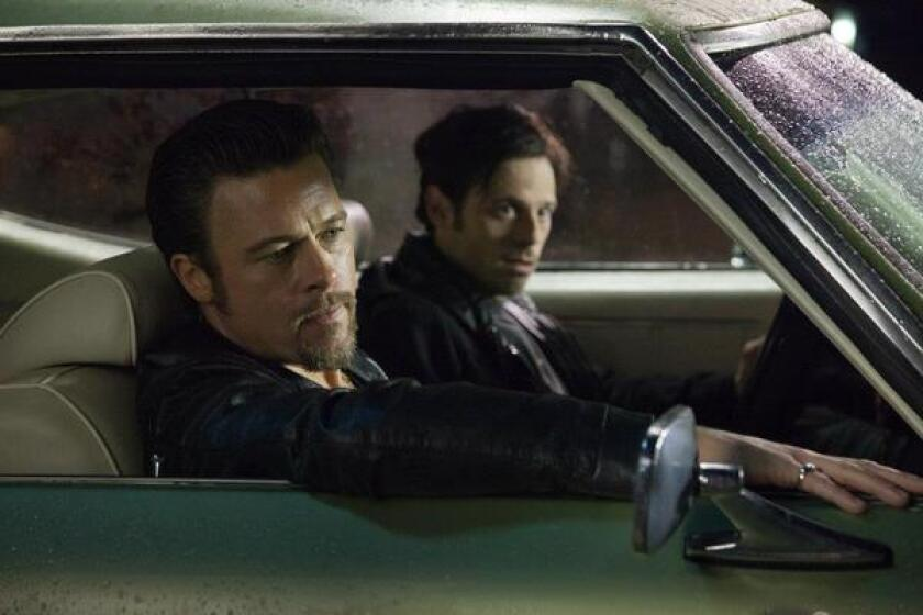 """Brad Pitt, left, and Scoot McNairy star in """"Killing Them Softly,"""" which bombed at the box office this weekend."""