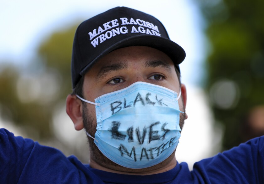 """Protester wearing mask with the words """"Black Lives Matter"""""""