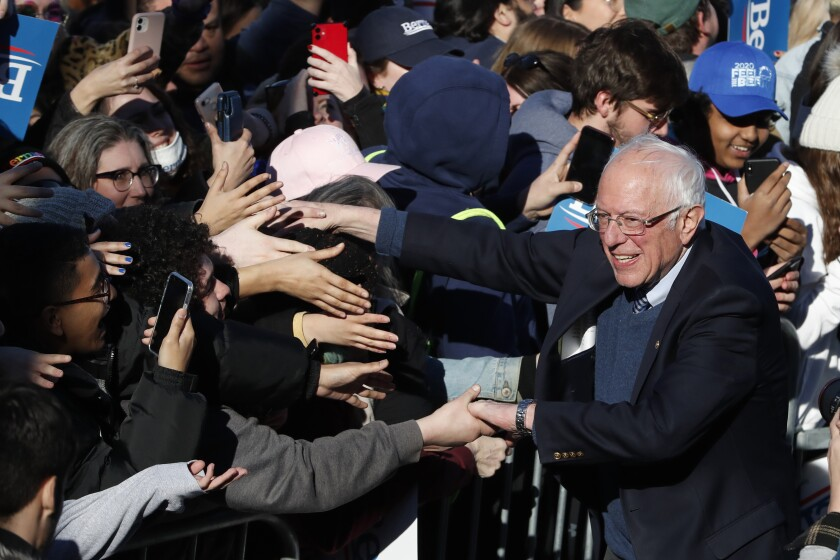 Democratic presidential candidate Sen. Bernie Sanders, I-Vt., works the crowd after speaking at a campaign rally in Chicago's Grant Park Saturday, March 7, 2020. (AP Photo/Charles Rex Arbogast)