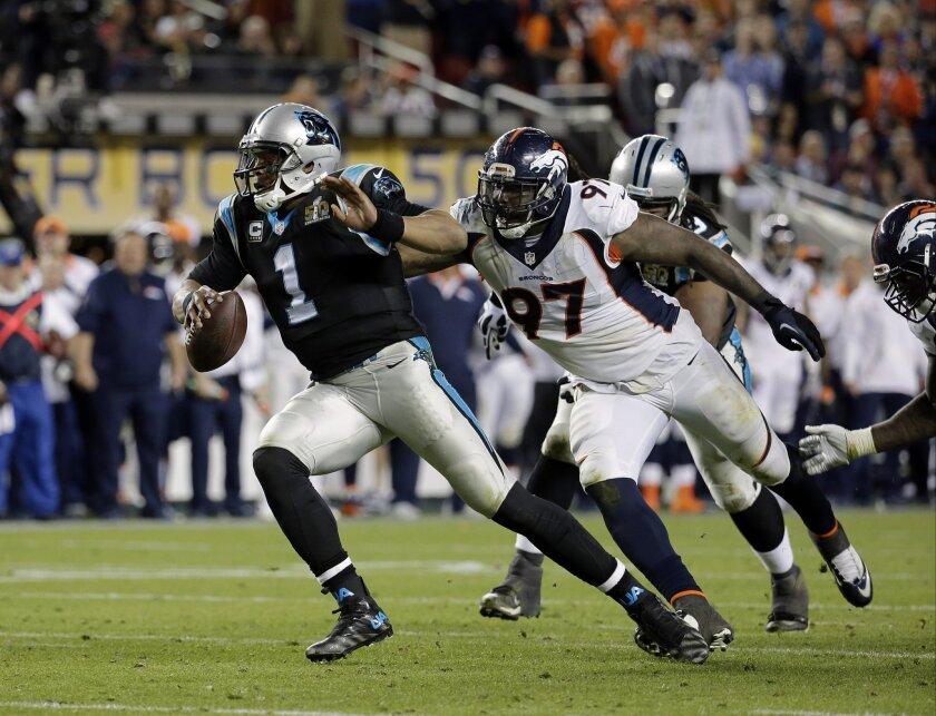 Carolina Panthers' Cam Newton (1) is chased by Denver Broncos' Malik Jackson (97) during the second half of the NFL Super Bowl 50 football game Sunday, Feb. 7, 2016, in Santa Clara, Calif. (AP Photo/Matt York)