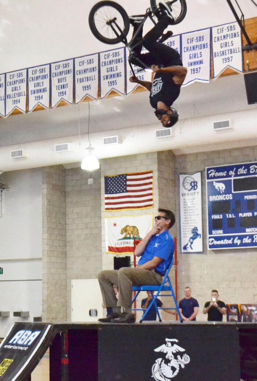 Mykel Larrin flipping over Principal Dave LeMaster.
