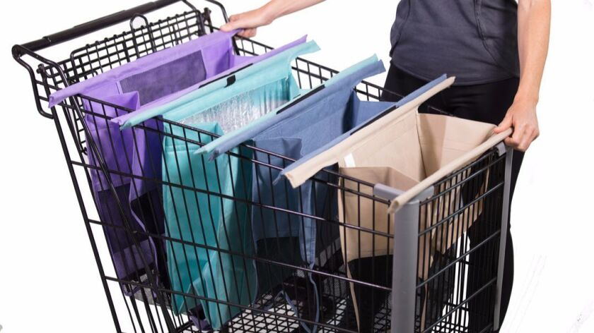 The Lotus Trolley Bag system includes three mesh-bottom bags and one insulated bag for frozen items.