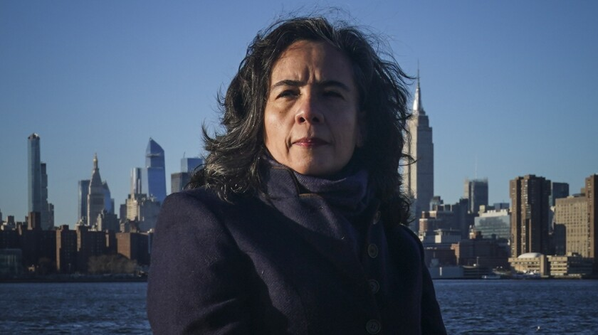 Dr. Oxiris Barbot, a pediatrician and former health commissioner for New York City during the coronavirus outbreak, poses for a portrait in the Brooklyn borough of New York, Monday Dec. 7, 2020. Barbot left her job as commissioner in August amid a clash with Democratic Mayor Bill de Blasio. (AP Photo/Bebeto Matthews)