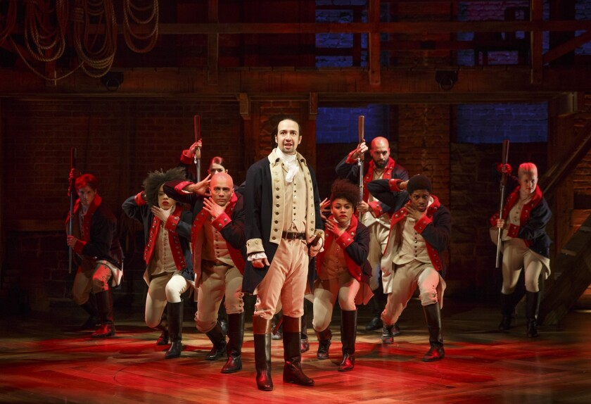 "Lin-Manuel Miranda, center, performs in the musical ""Hamilton"" in New York."