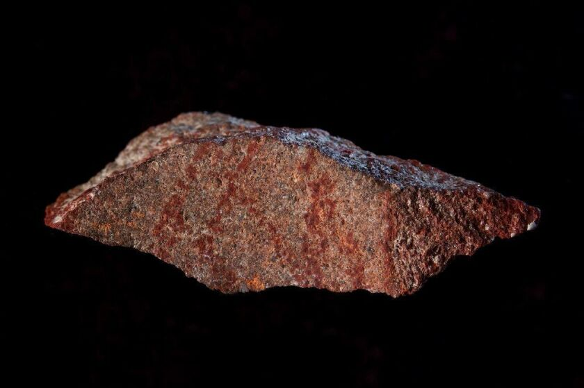 A drawing made with ochre pigment on silcrete stone, found in South Africa's Blombos Cave.