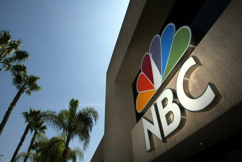 The NBC peacock logo can be seen on the former NBC Studios building in Burbank in 2003. NBC has threatened a blackout this weekend if Dish Network fails to strike a deal with it.