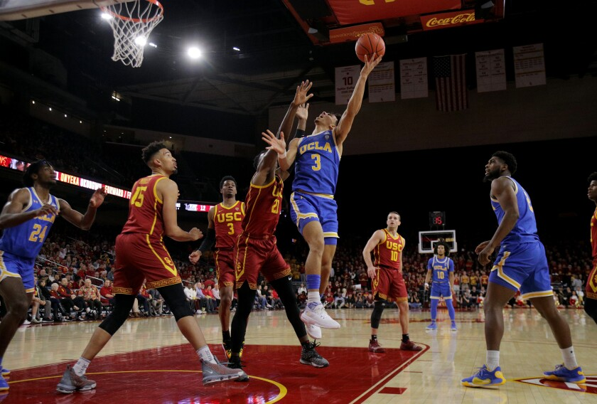 UCLA guard Jules Bernard drives to the basket against USC forward Onyeka Okongwu on March 7 at Galen Center.