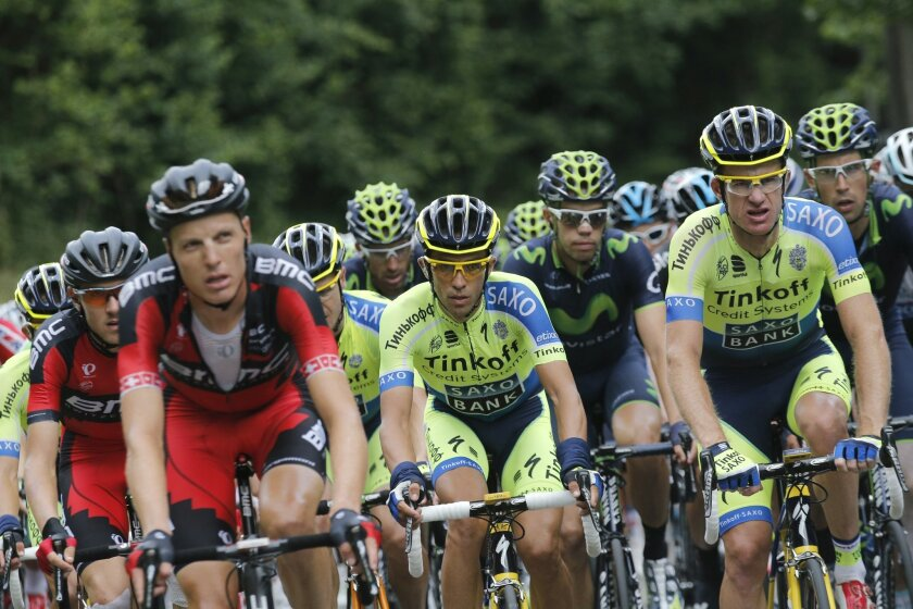 Spain's Alberto Contador rides in the pack during the ninth stage of the Tour de France cycling race over 170 kilometers (105.6 miles) with start in Gerardmer and finish in Mulhouse, France, Sunday, July 13, 2014. (AP Photo/Christophe Ena)