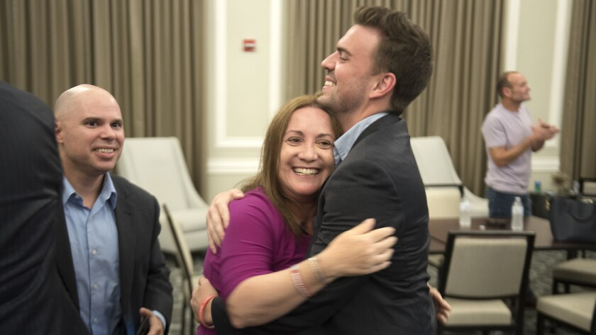 Lori Alhadeff hugs her finance director Sam Cook while celebrating a lead in the District 4 Broward