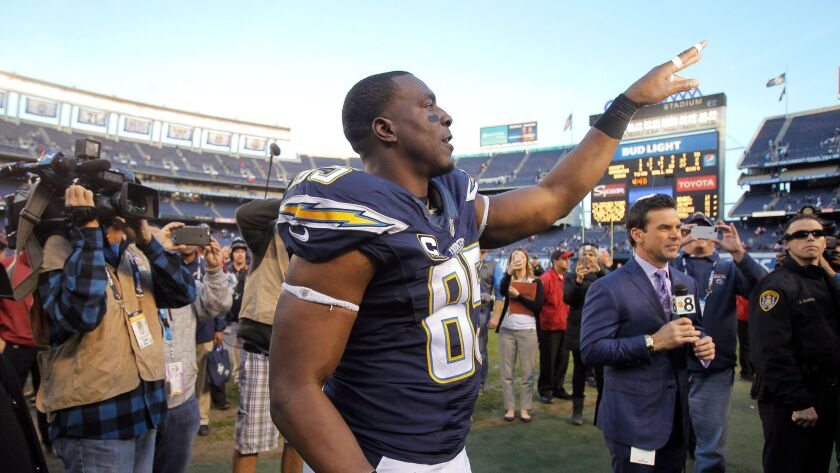 The Chargers' Antonio Gates tosses a glove to fans after the Chargers lost to Kansas City 37-27 at Qualcomm Stadium in San Diego on Sunday.