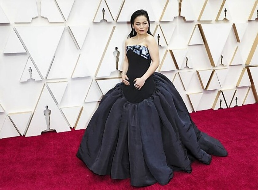 San Diego native Kelly Marie Tran on the red carpet at the 92nd Academy Awards on Feb. 9, 2020 is wearing an elegant dress by Schiparelli.