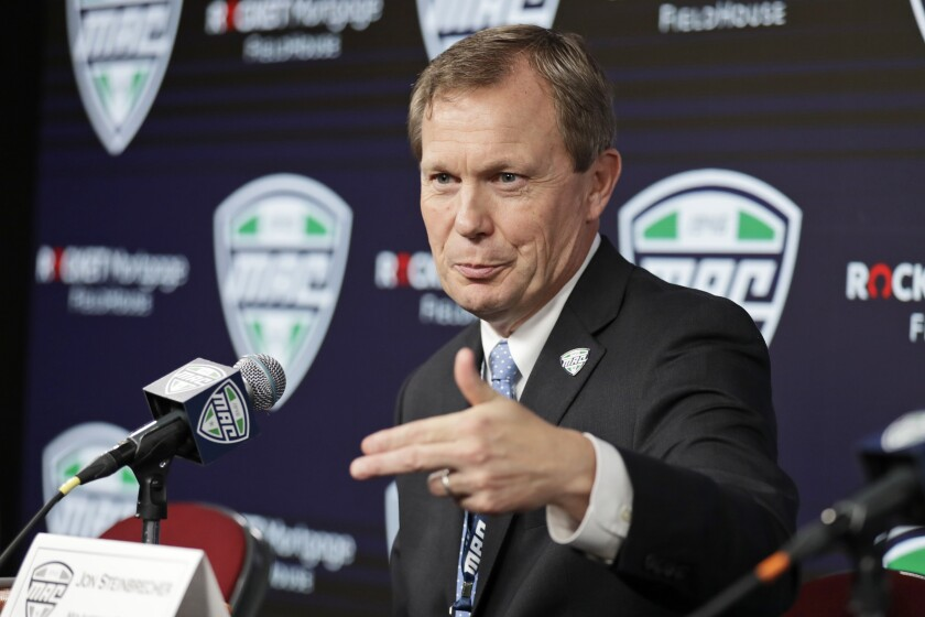 Mid-American Conference Commissioner Jon Steinbrecher speaks during a news conference.
