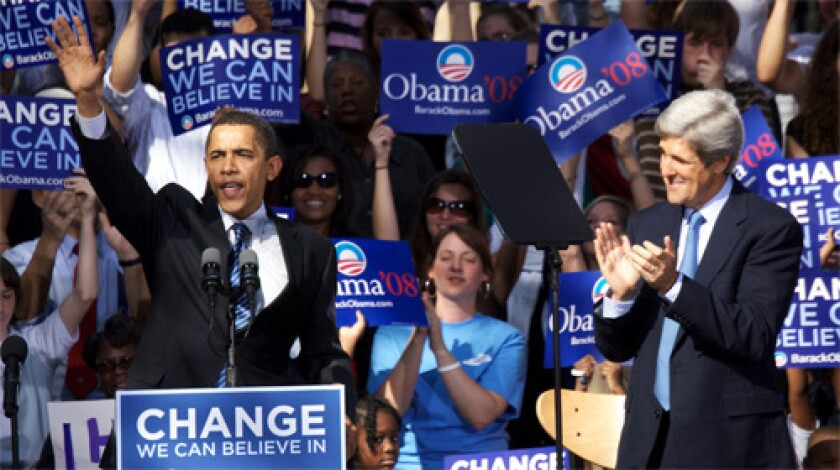 ENDORSMENT: Democratic presidential candidate Sen. Obama smiles and waves with Senator John Kerry at the College of Charleston in Charleston, S.C.