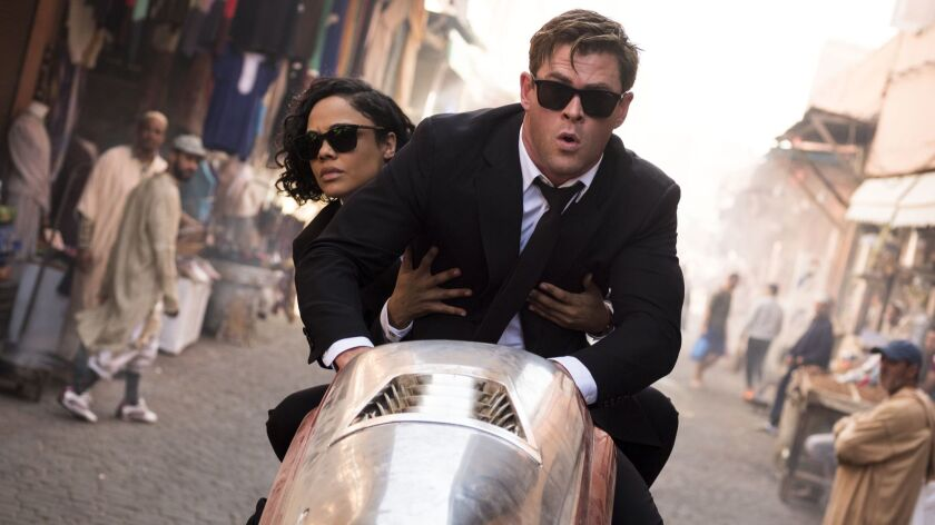 This image released by Sony Pictures shows Chris Hemsworth, foreground, and Tessa Thompson in a scen