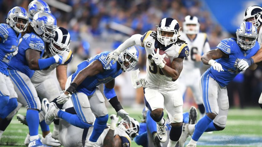 DETROIT, MICHIGAN DECEMBER 2, 2018-Rams running back Todd Gurley breaks free from the Lions defense