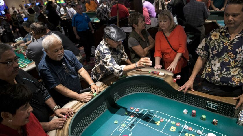 Richard Favela tosses the dice during a qualifying round at the California Hotel and Casino Golden A