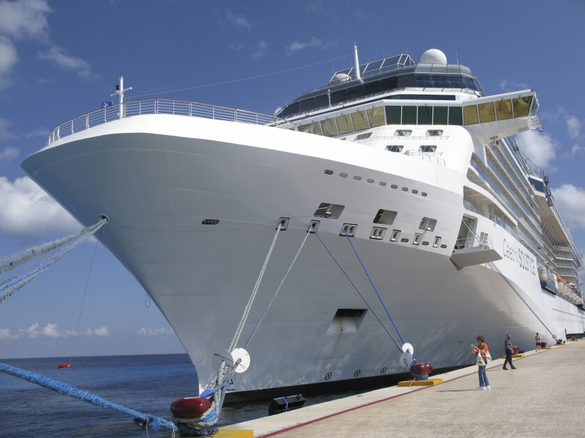 FILE - In this June 9, 2010 file photo, the Celebrity cruise ship Solstice is docked in Cozumel, Mexico. With tourism shattered by the COVID-19 pandemic in 2021, Mexico's Caribbean island of Cozumel is planning with the backing of President Andres Manuel Lopez Obrador another dock for cruise ships. (AP Photo/J Pat Carter, File)