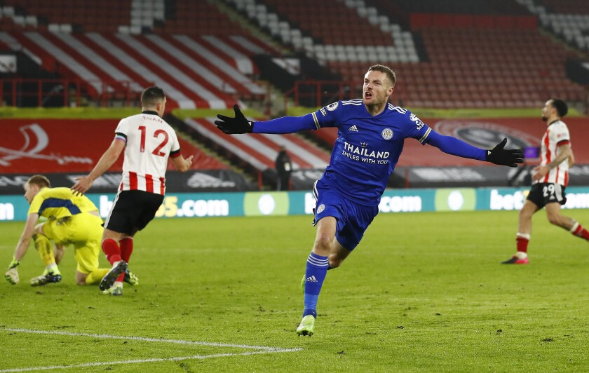 Leicester's Jamie Vardy celebrates after scoring his side's second goal during the English Premier League soccer match between Sheffield United and Leicester City, at the Brammall Lane Stadium in Sheffield, England, Sunday, Dec. 6, 2020. (Jason Cairnduff, Pool via AP)