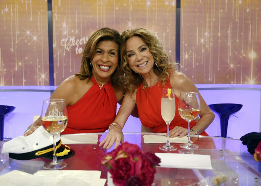 """Today"" show hosts Hoda Kotb, left, and Kathie Lee Gifford on the set in New York, Friday, April 5, 2019, on Gifford's last day as co-host."