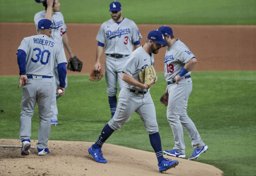 Dodgers pitcher Adam Kolarek exits the game in the second inning of Game 3 of the National League Division Series.