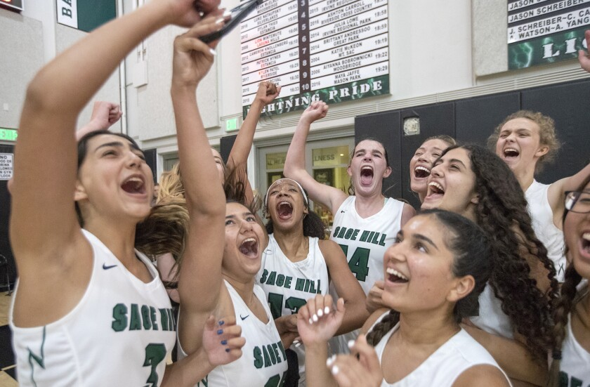 Sage Hill celebrates a 62-55 win over Ontario Christian in the CIF Southern Section Division 3AA girls' basketball final.