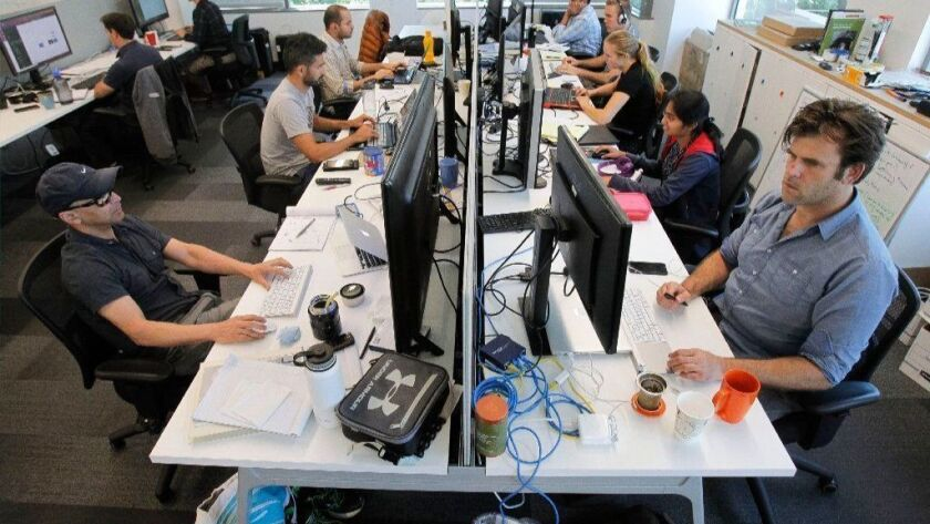 The team at startup CureMetrix working at EvoNexus.