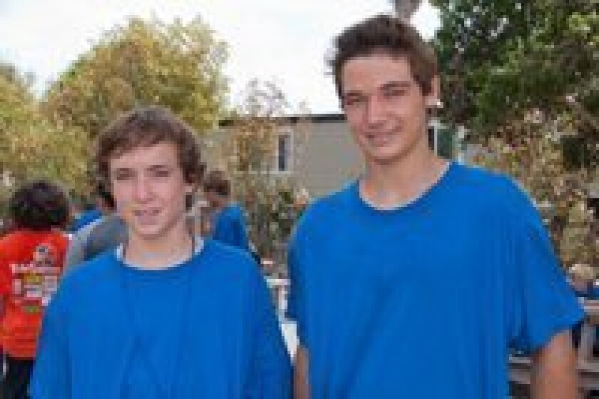 """From left: Michael Stewart, 14, and Jason """"JT"""" Henderson, 13, started the free kids' camp called Goals for Kids."""