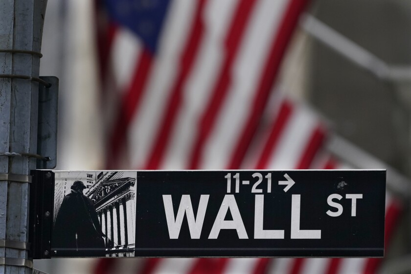 A street sign for Wall Street in New York