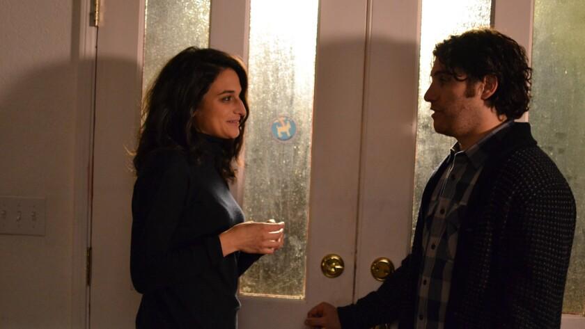 "Jenny Slate and Adam Pally in ""Joshy."""