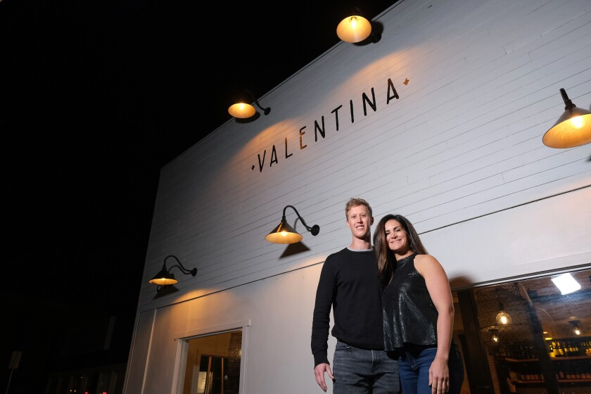 SAN DIEGO, CA-NOVEMBER 13, 2019: David and Carina pose for a photo in front of Valentina in Encinitas after spending the initial part of their date next door at CLAY + CRAFT in Encinitas. (Misael Virgen / PACIFIC Magazine)