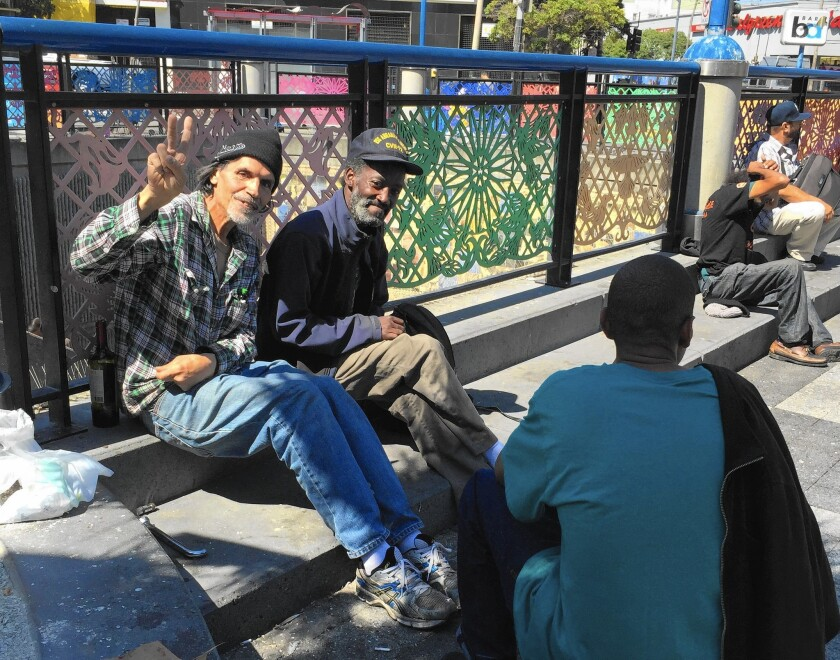 At the BART plaza at 16th and Mission streets in San Francisco, Bill Garza, left, and Ronnell Hunt talked about how hard it is to find a restroom.