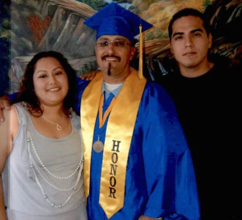 While incarcerated in Ironwood State Prison in Blythe, Luis Vargas earned his associate's degree and was joined at his prison graduation ceremony by his daughter, Crystal, and his son, far right.