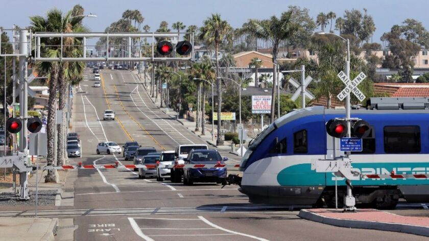 An eastbound Sprinter train crosses Coast Highway in South Oceanside.