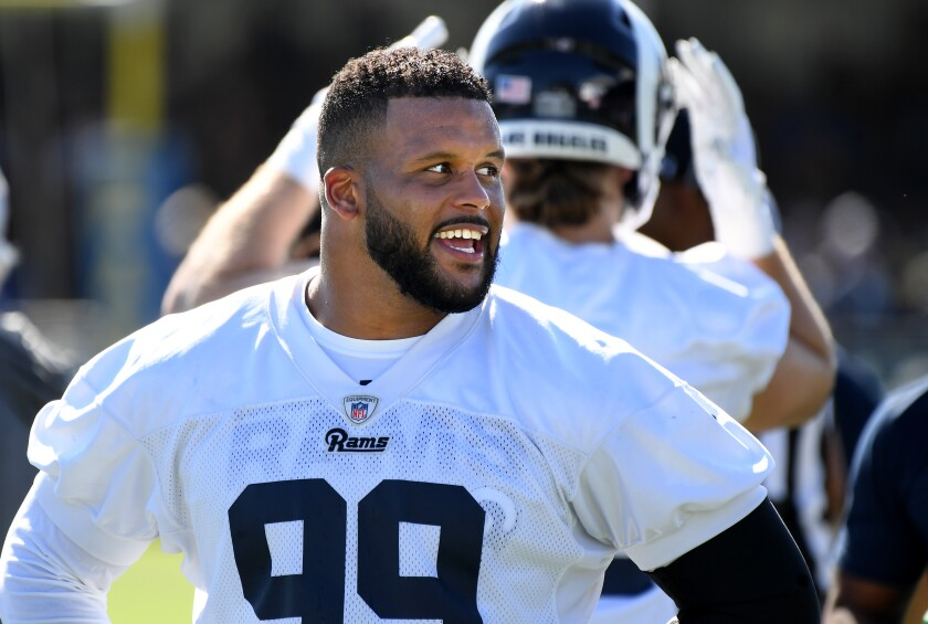 Rams defensive tackle Aaron Donald takes a break during the first day of training camp at UC Irvine on Saturday.