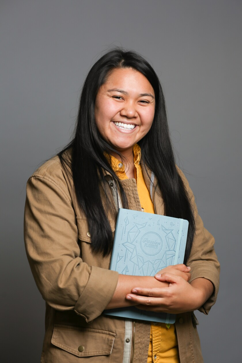 Angelia Trinidad, San Diego native and founder of Passion Planner, holds one of her planners