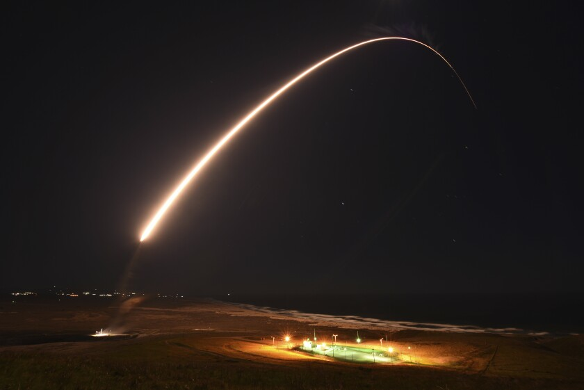 FILE - In this Feb. 23, 2021, file photo released by the U.S. Army Space and Missile Defense Command, an unarmed Minuteman 3 intercontinental ballistic missile launches during an operation test at Vandenberg Air Force Base, Calif. California's Vandenberg Air Force Base will be renamed as a U.S. Space Force Base. The name will be changed to Vandenberg Space Force Base during a ceremony Friday, May 14, 2021, on the parade field. The sprawling Central Coast base tests ballistic missiles and conducts orbital launches for defense, science and commercial purposes. (Brittany E. N. MurphyU.S. Army Space and Missile Defense Command via AP, File)