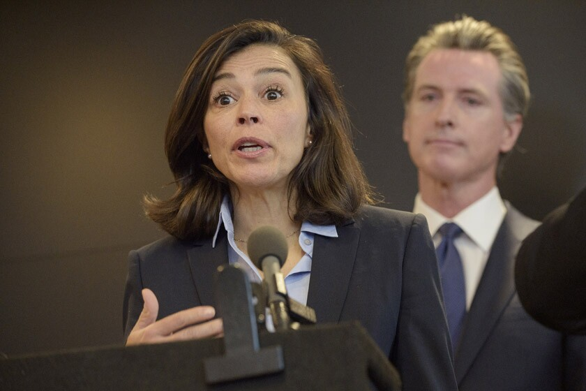Dr. Sonia Angell is joined by California Gov. Gavin Newsom during a news conference on Feb. 27.