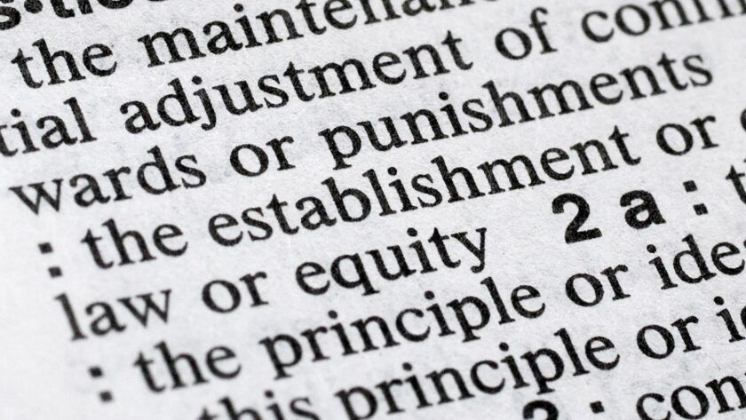 """The word """"justice"""" is displayed in a Merriam-Webster dictionary in New York. Merriam-Webster has chosen """"justice"""" as its 2018 word of the year, driven by the churning news cycle and President Trump's Twitter feed."""