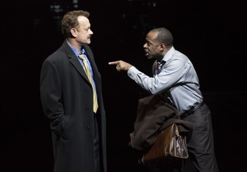 """This theater image released by Boneau/Bryan-Brown shows Tom Hanks as tabloid columnist Mike McAlary, left, and Courtney B. Vance as editor Hap Hairston during a performance of """"Lucky Guy,"""" playing at the  Broadhurst Theatre in New York.  (AP Photo/Boneau/Bryan-Brown, Joan Marcus)"""
