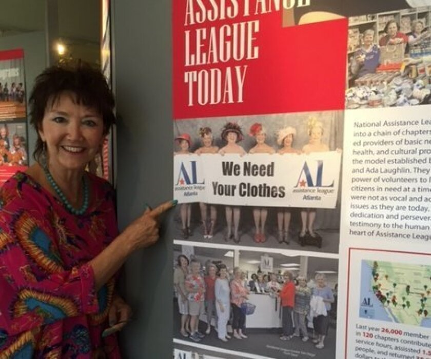 Ashley Gardner, executive director of the Women's Museum of California, welcomes visitors to a new exhibit, 'From Victorian Parlor to 21st Century Boardroom: The Story of Assistance League in America.'