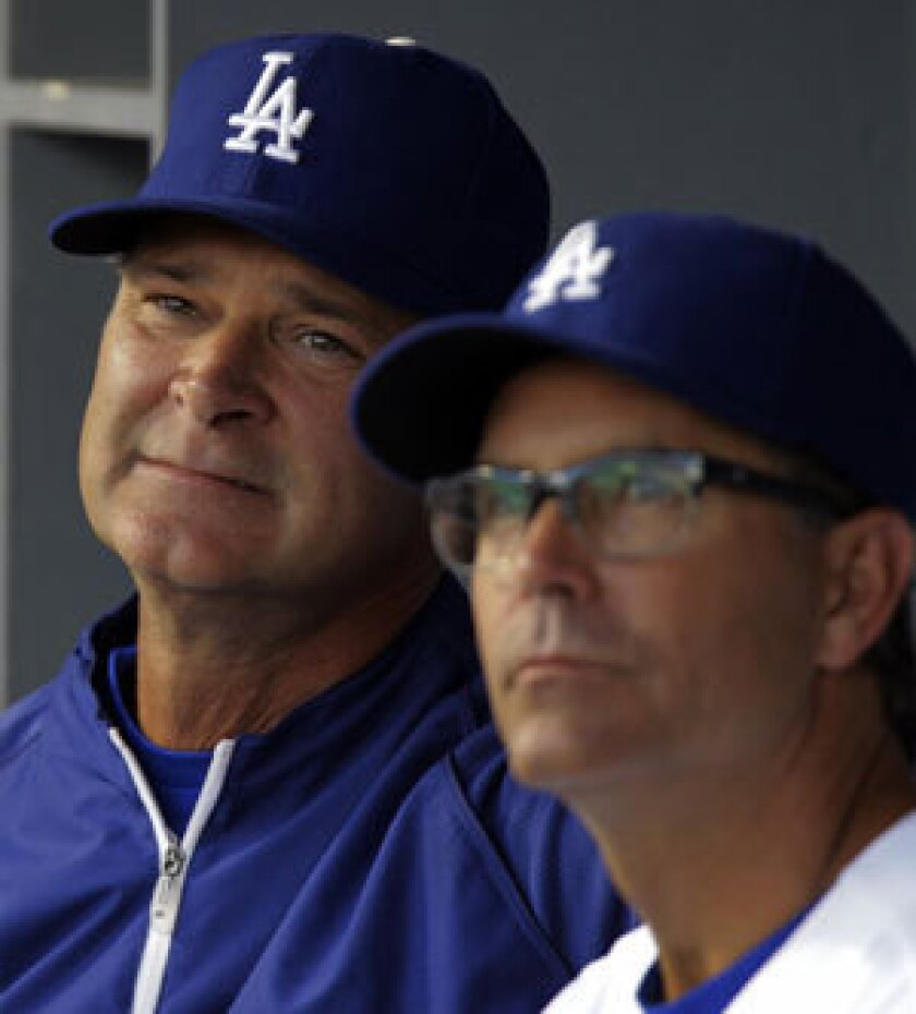 Don Mattingly, left, and Trey Hillman during a game in June.