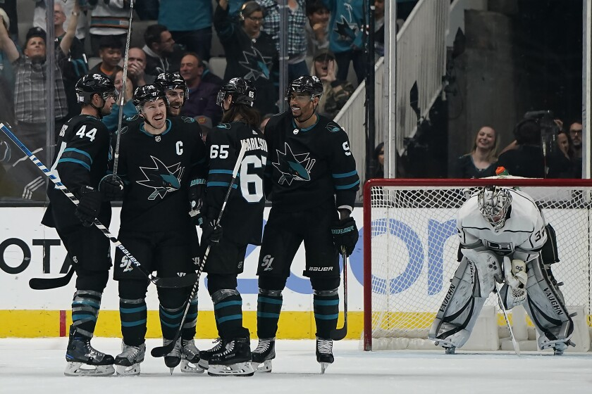 Sharks center Logan Couture celebrates with teammates after scoring a goal against the Kings on Nov. 29, 2019.